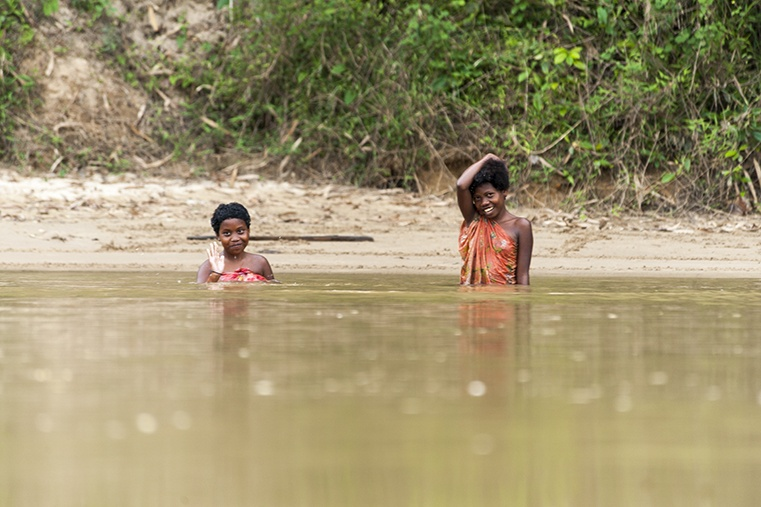 Two Orangasli girls swimming