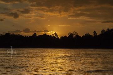Uncle Tan Sunset over the Kinabatangan