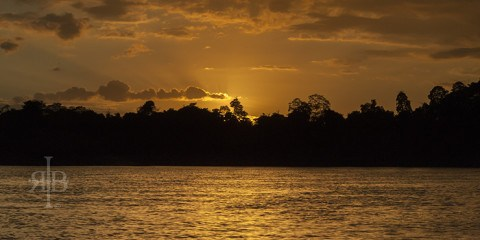 Uncle Tan Sunset over the Kinabatangan