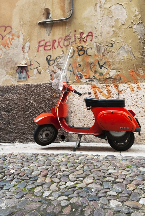 red vespa cobbled street