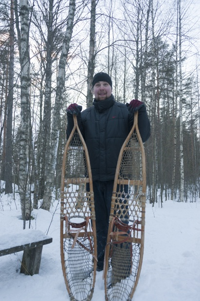 Host from Okkolan Lomamokit with traditional snow shoes