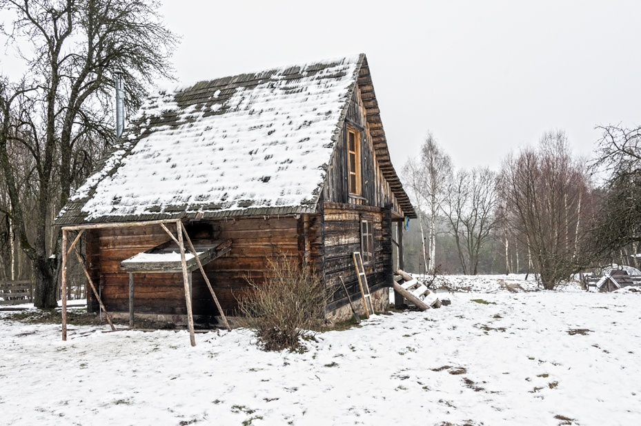 wooden home snow lithuania