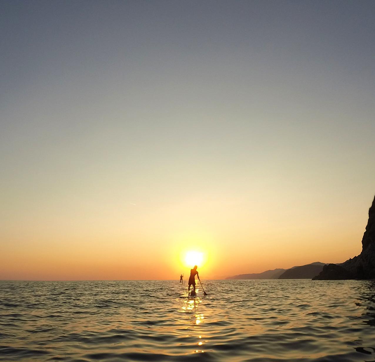 sunset paddle boarding levanto