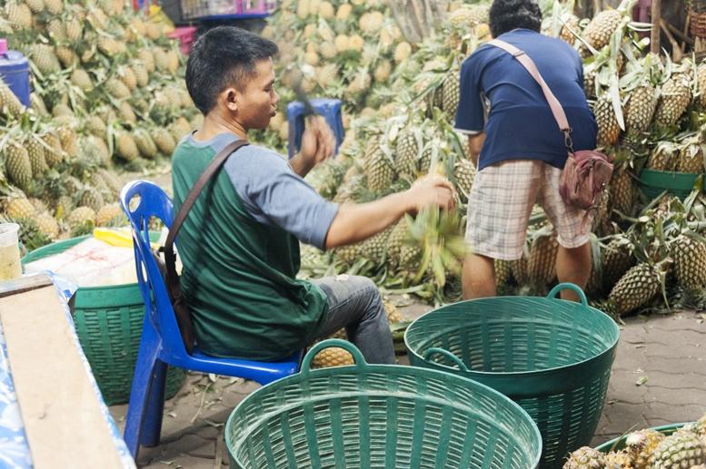Bangkok night vegetable market pineapples