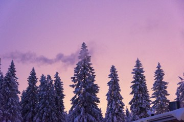 skiing in finland purple sky