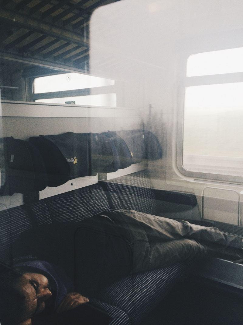 man sleeping on train italy