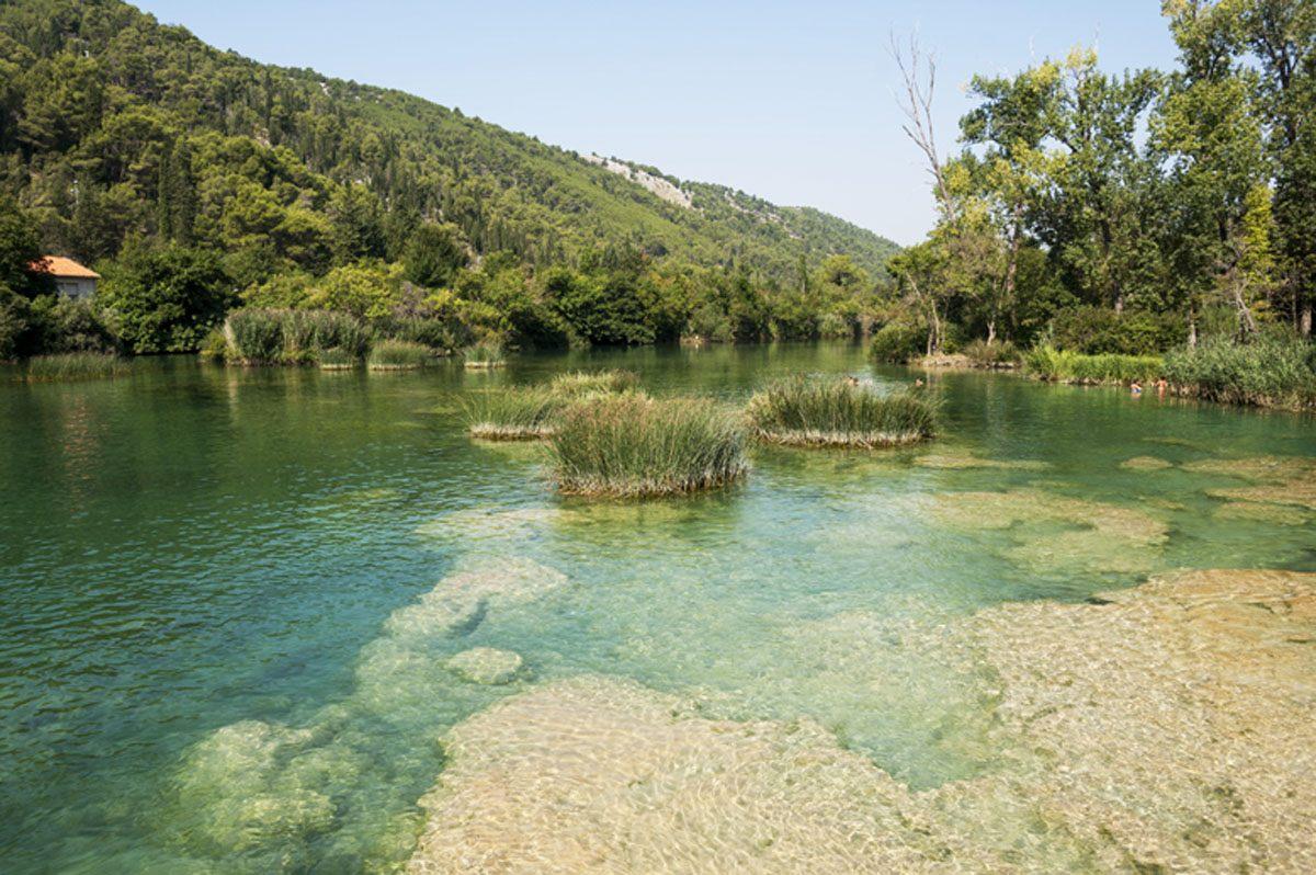 The clear waters of the Krka river near Skradiski Buk