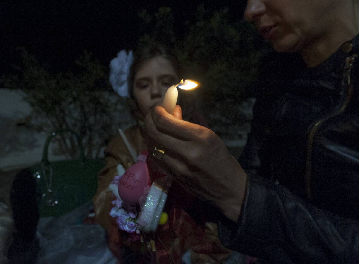 easter astypalea greek island girl with candle