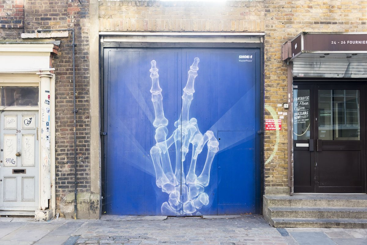 shoreditch street art skeleton hand