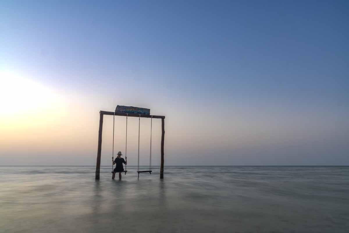 holbox sunset swing