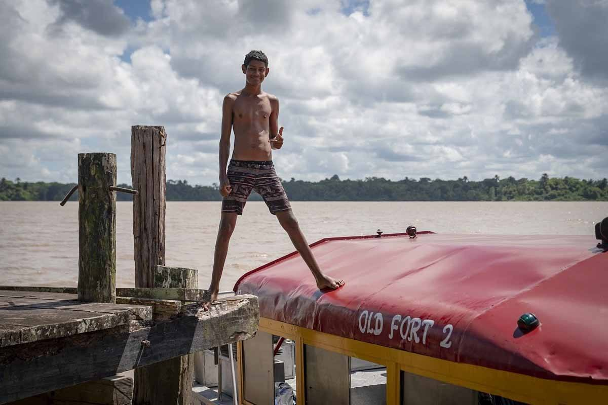 essequibo river local boy guyana