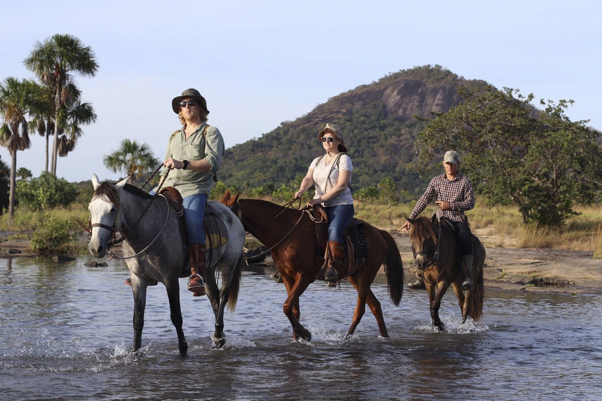 horse riding across river guyana
