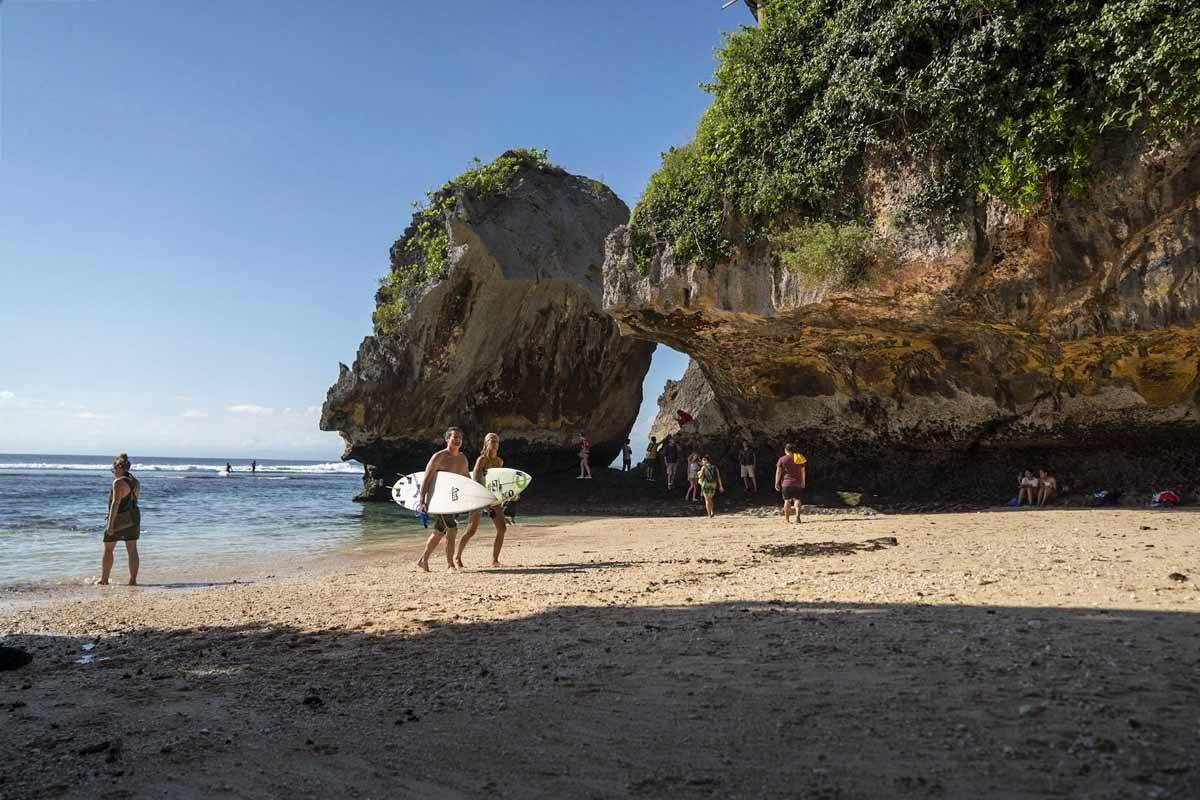 Surfers on Suluban Beach, Uluwatu