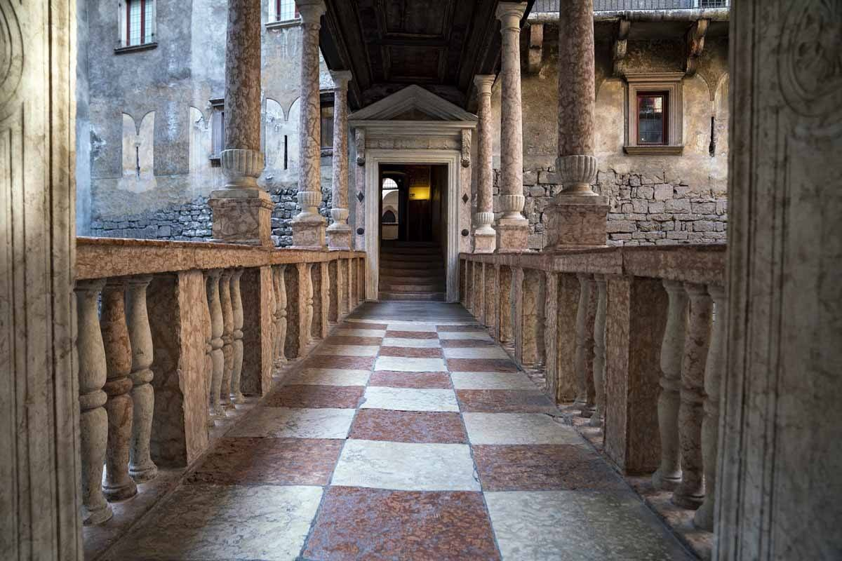 A corridor in Buonconsiglio Castle, columns and checked floor
