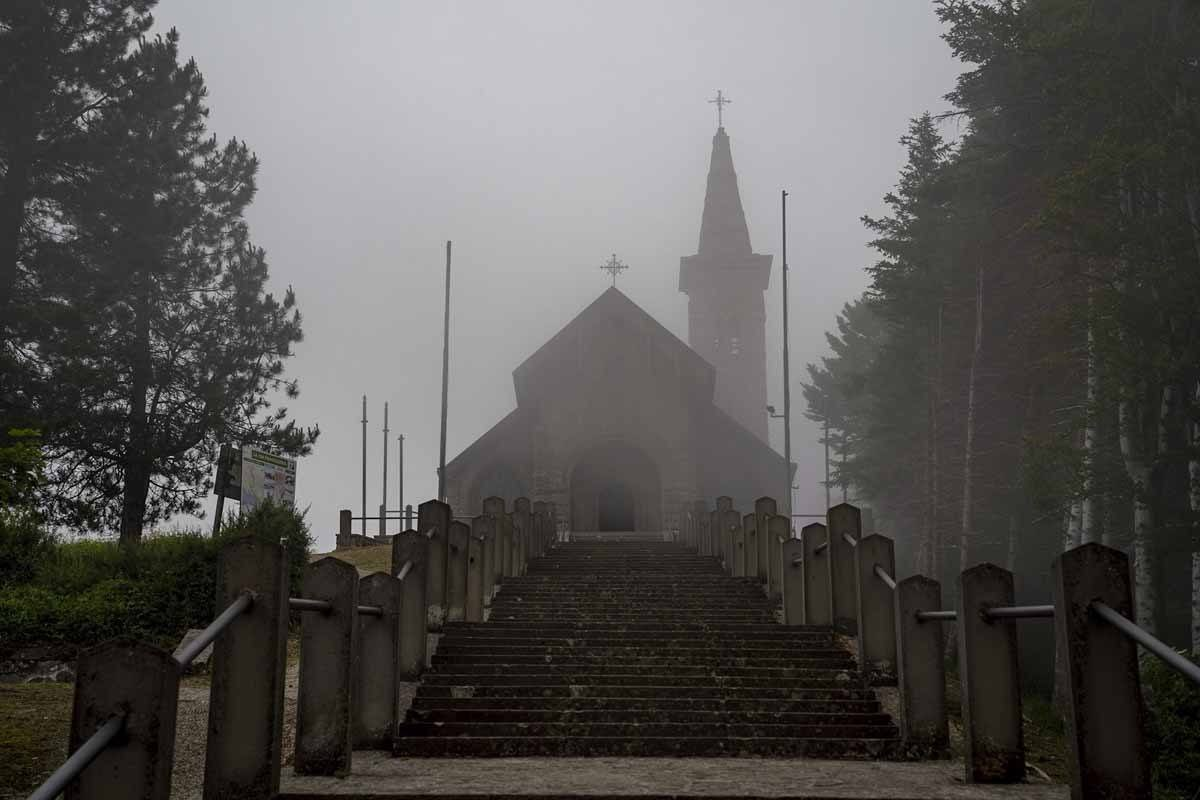 The tiny church on Cisa Pass in the fog