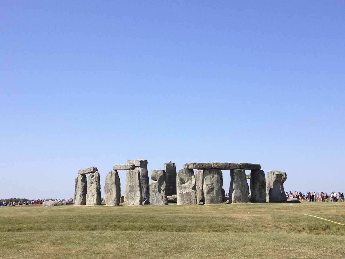 visit stonehenge blue sky
