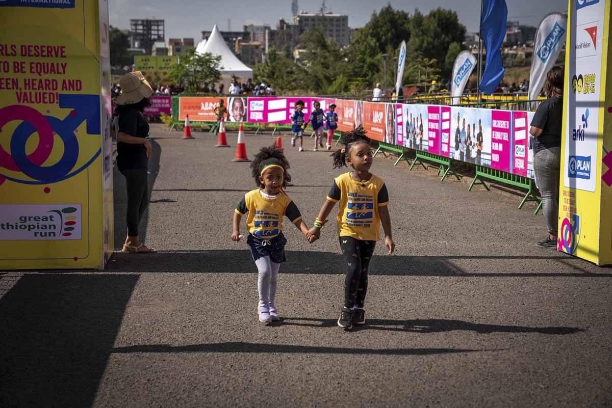 great ethiopian run children twi girls holding hands